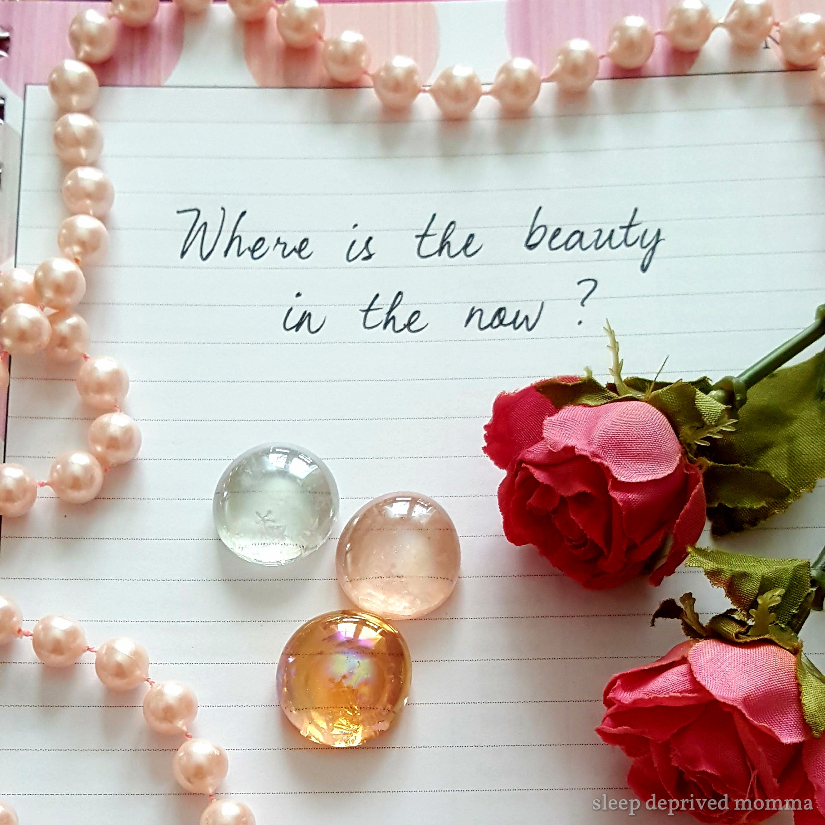 writing on a page with roses and pearls.jpg